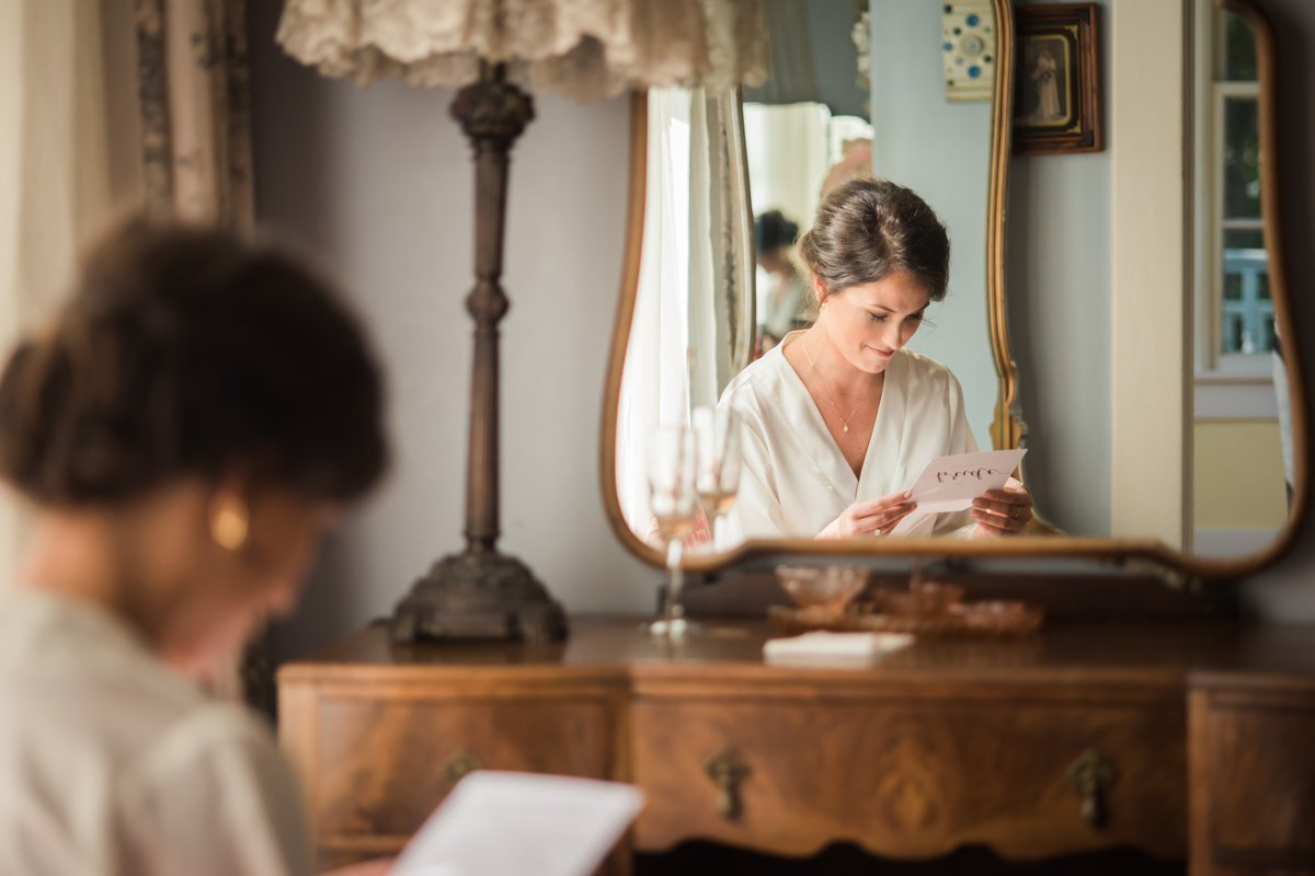 Chic Butlers Courtyard Wedding Bride reading letter