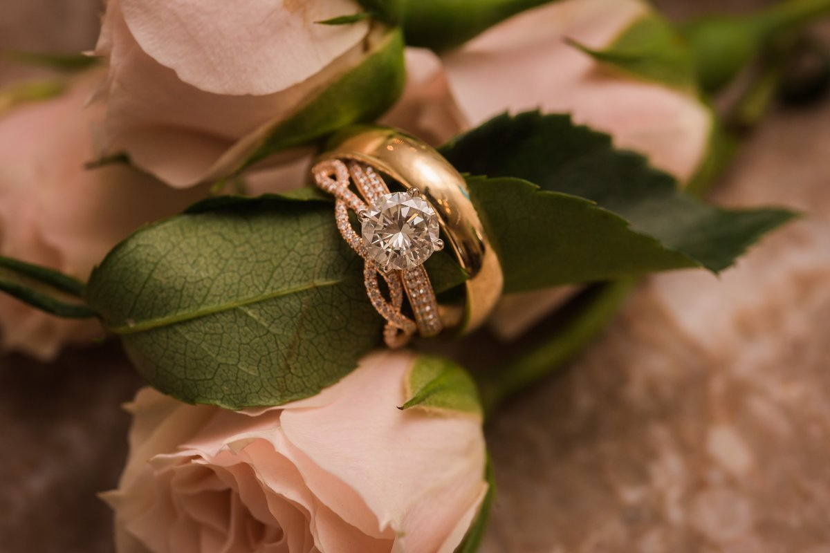 Gorgeous Rose Gold Rings with Blush Flowers at Chic Butlers Courtyard Wedding
