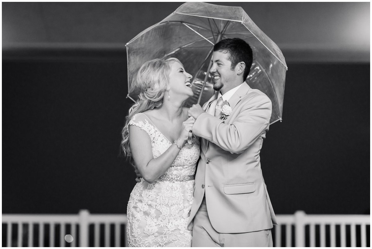 The Admiral on Clear Lake Wedding Bride and Groom in the rain